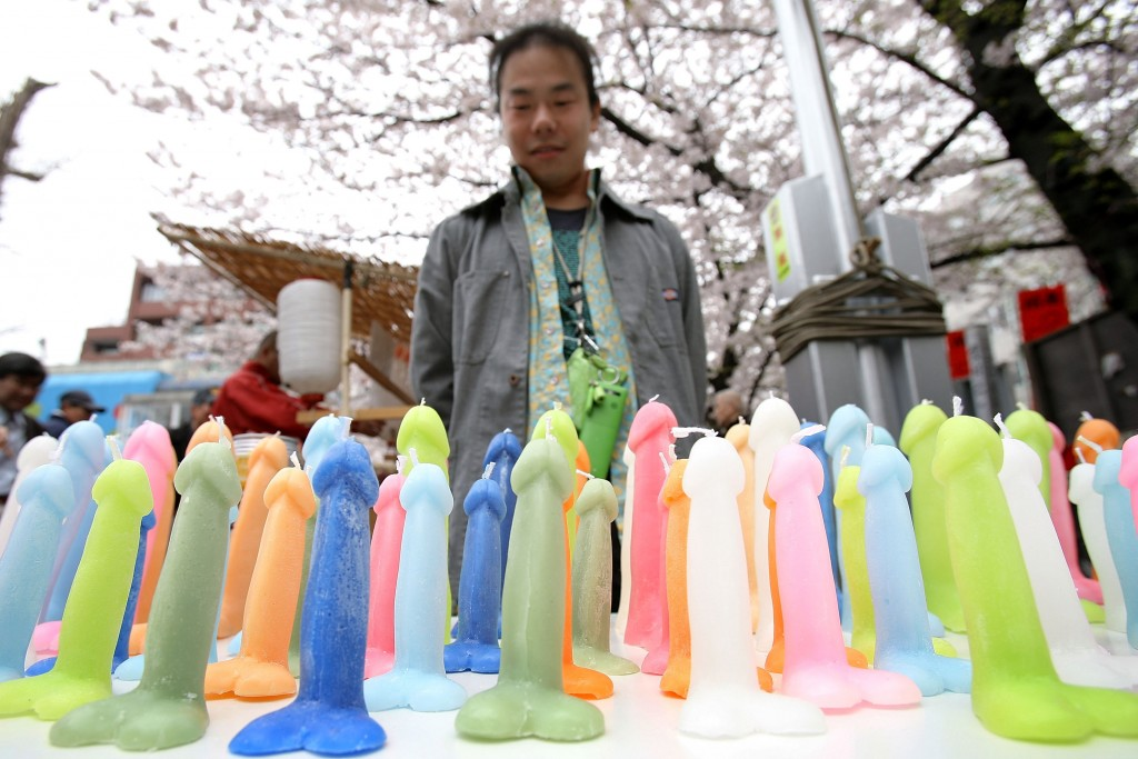 KAWASAKI, JAPAN - APRIL 05:  A man sells phallus-shaped candles during the Kanamara Festival, or the Utamaro Festival, at Wakamiya Hachimangu Shrine on April 5, 2009 in Kawasaki, Japan. The annual feritility festival, held traditionally in the cherry blossom season since the Edo era (1603-1868), is said to encourage fertility and bring harmony to married couples. In recent times the festival has raised awareness of AIDS prevention.  (Photo by Kiyoshi Ota/Getty Images)